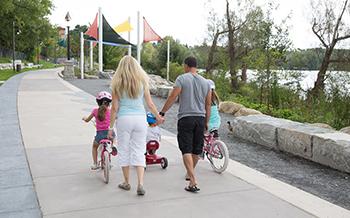 Family walking in Lake Wilcox Park